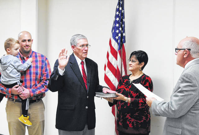 "Surrounded by family and friends, Bill Fawley took the oath of office for an eighth term as Highland County auditor at a ceremony late Tuesday afternoon. The swearing-in ceremony took place in the Highland County Administration Building, one floor below the office the 72-year-old Lynchburg native has served in since being first elected in 1990. Administering the oath of office was Highland County Clerk of Courts Dwight ""Ike"" Hodson, a longtime Fawley friend. Fawley recently announced his retirement, but said he intends to continue serving in the office he was re-elected to last November. Pictured, from left, are Bill's son Will Fawley holding his son Dax, Bill Fawley, his wife Dianne holding a family Bible, and Hodson."