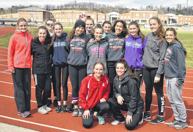 The Hillsboro High School Lady Indians Track and Field team gathers for a group photo on Friday at the Hillsboro Track and Field complex.