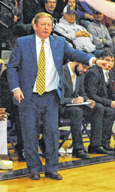 In this Times-Gazette file photo McClain Head Coach Joe B. Stewart directs the Tigers' defense from the sideline in a January 5, 2019 home game against the Fairfield Lions.