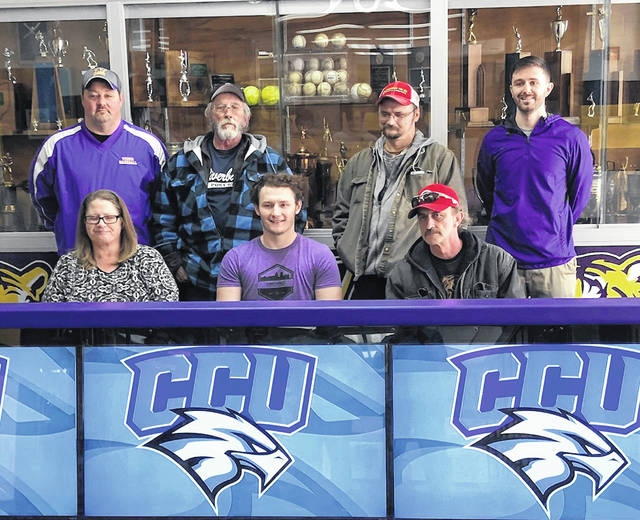 McClain Senior baseball standout John Salyers signed with Cincinnati Christian on Wednesday at McClain High School. Salyers is a four year letterman with the Tigers baseball program and competes in Legion Baseball during the summer months. Pictured front row (l-r): Pam Smith (Mother), John Salyers, Johnny Salyers (Father). Back row (l-r): Coach Rich Bunner, Brad Salyers (Grandfather), Ron Salyers (Uncle), Athletic Director Trevor Arnett.
