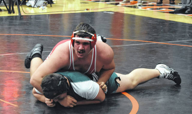 Hillsboro's Lane Cluff maintains a favorable position in his 285 pound match in the District Wrestling Tournament at Wilminton High School on Friday. Cluff finished as the runner up in the District Tournament and earned a spot in the State Tournament.