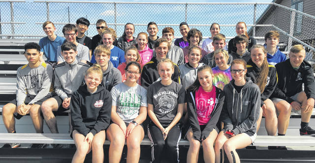 """Pictured front row (l-r): Raelynn Rubble, Philemina Toca, Mia McCammon, Jessy Mullenix and Mae Quiley. Second row (l-r): Andre Cumberland, Gavin Frazier, Quinn Brown, Ashlynn Yates, Daniel Bohl, Audrey Merry, Miranda Lawhorn, Brooklynn Laymon and Austin Wilkin. Third row (l-r): Robbie McIntosh, Alana Miller, Cat Knope, Conner Tyree, Hunter Balon, Dawson Osborn, Cole Parker and Nathan Brown. Fourth row (l-r): David Burton, Tony You, Draiden Doughman, Jennifer Zwielser, Tristan Wiederhold, Abigail Brioli, Allison Kohus and Serene Walker. Lynchburg-Clay Track and Field head coach James O'Connor said, """"This year's track team is very young. That means about everyone will come time running on the varsity team and have a chance to contribute. It also means we will be relying on underclassman a lot more than usual in relays and other events."""""""