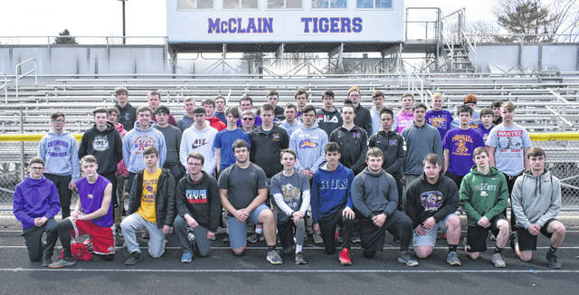 The McClain Tigers boys Track and Field team gathers for a team photo on the McClain High School track.