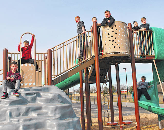 With the official start of spring just a few days away (the spring equinox is at 5:58 p.m. March 20 this year, according to The Old Farmers Almanac) some local youngsters took advantage of warmer weather Tuesday after school hours to enjoy some time on the Hillsboro Elementary Playground. Pictured, from left, are Alex Bennett, Logan Holland, Jack Cornele, Kainen Allen, Andy Bennett, Laney Holland, Luke Holland and Landon Holland (below on the slide). The National Weather Service was forecasting a high of 63 for Wednesday with a high of 69 on Thursday, although the NWS was predicting possible storms after 2 p.m. Thursday and breezy weather with winds of 15-22 mph and gusts as high as 41 mph.