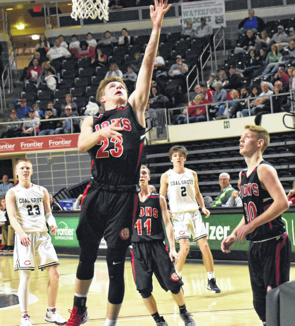 Fairfield's Sam Buddelmeyer attempts a layup against Coal Grove in a Southeast District Semi-Final game at the Convocation Center in Athens.