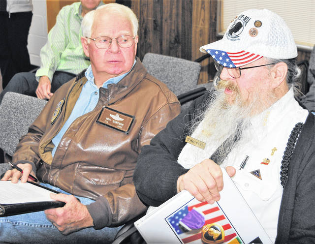Retired Air Force Col. Ronald Sampson (left) and Gerold Wilkin of the Highland County Veterans Honor Guard met with commissioners Wednesday asking for official recognition of March 29 as Vietnam War Veterans Day. They also asked that March 30 be proclaimed as a day to honor PFC David McConnaughey and Cpl. James Waulk Jr., who were the first and last soldiers, respectively, from Highland County to die in Vietnam.