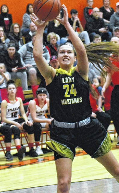 Lynchburg-Clay Senior Peyton Scott is pictured attempting a leaning jumper on Saturday, March 2, in a D III Southeast District Final in Waverly. Scott was honored by the OPSWA on Tuesday when she was announced as a member of the OPSWA All-Ohio First Team in D III.