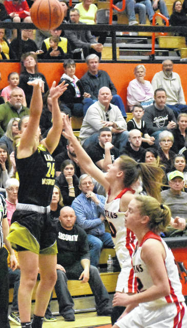 Lynchburg-Clay senior Peyton Scott take a three ppinter with a hand in her face Saturday at the Waverly Downtown Arena in a D III District Final game against the Alexander Lady Spartans.