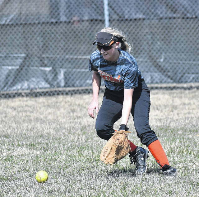 Whiteoak Senior Sydnie Raines makes a play on the ball in the outfield Tuesday at Whiteoak High School where the Lady Wildcats were preparing for the start of the 2019 season.