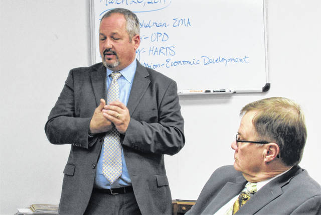 Tim Young, left, of the Ohio Public Defender's office in Columbus, presented Wednesday to the Highland County commissioners what his office could offer to help with the county's legal costs for indigent defense. At right is Highland County Common Pleas Court Judge Rocky Coss.