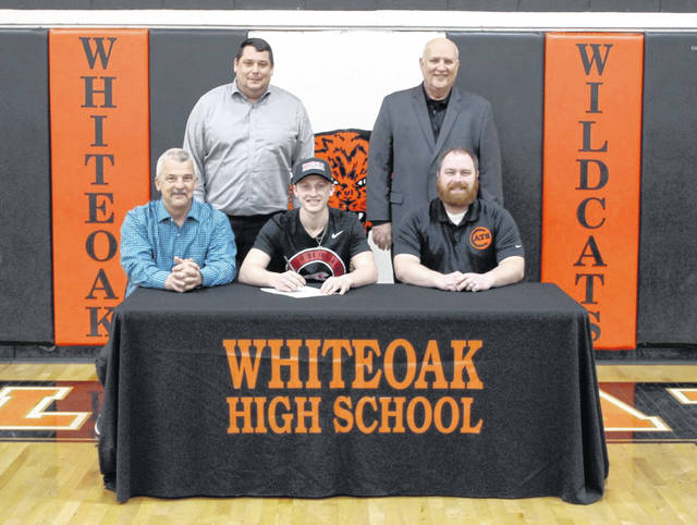 Whiteoak senior Traeten Hamilton signed his letter of intent to play baseball at the University of Indianapolis on Friday at Whiteoak High School. Pictured front row (l-r): Wildcats' Head Coach Chris Veidt, Hamilton and Wildcats' Assistant Coach John Combs. Back row (l-r): Whiteoak High School Principal Brian Ruckel and Bright Local Superintendent Ted Downing.