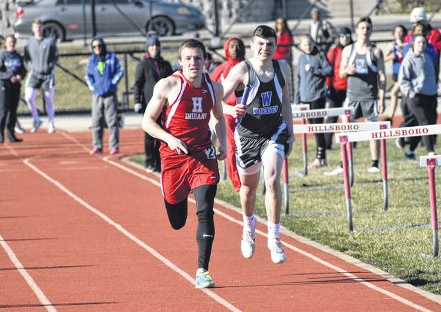 Hillsboro's Ty Alexander races past a Washington High School athlete in the final 100-meters of the boys 4x800-meter relay Tuesday at Hillsboro High School where the Indians hosted the Blue Lions in a dual meet. The Hillsboro boys 4x800-meter relay team finished first in the event.