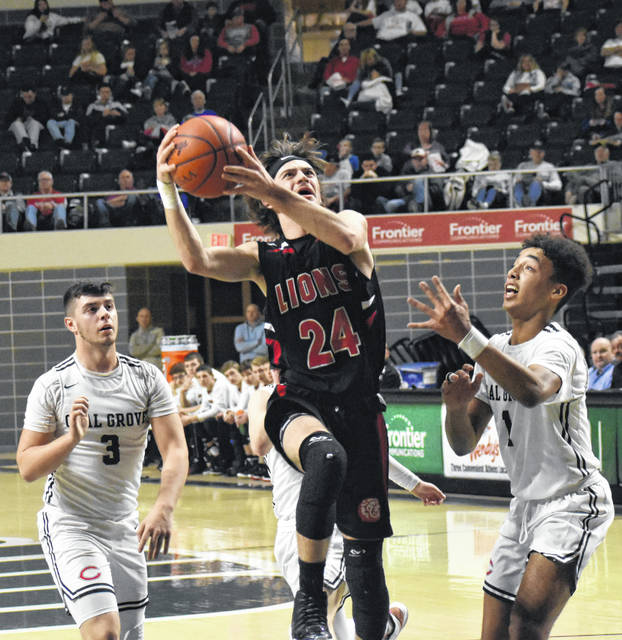 Fairfield's Wyatt Willey drives hard into the lane and rises up for a layup on Sunday at the Convocation Center in Athens where the Lions took on Coal Grove in a D IV Southeast boys District Semifinal matchup.