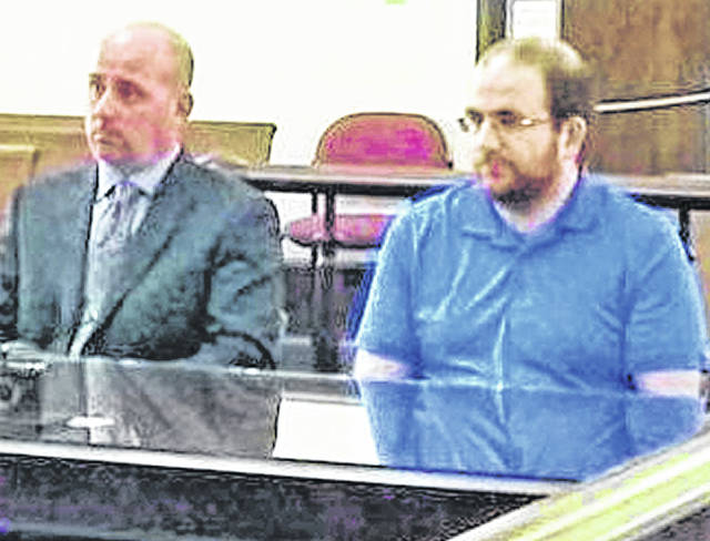 Benjamin J. Wright, right, is pictured at a previous court appearance with his attorney, J.D. Wagoner.