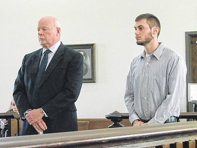 Adam Seth Perry, right, stands in Highland County Common Pleas Court on Wednesday with attorney Bill Armintrout.