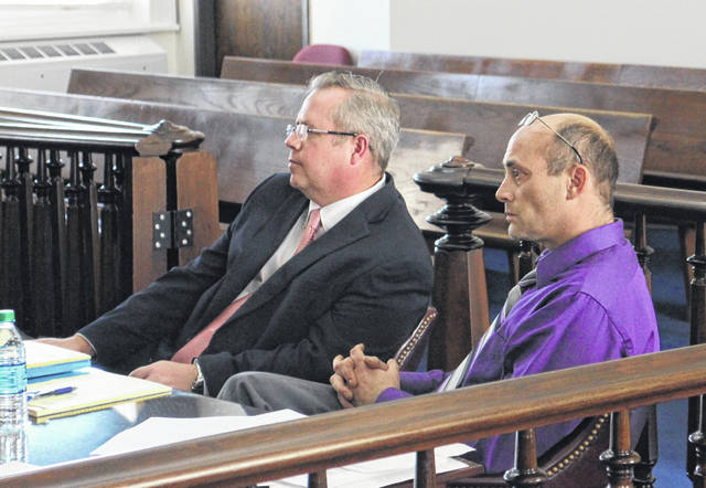 Shawn Ervin, right, is shown at a previous court hearing with attorney Lee Koogler, left.
