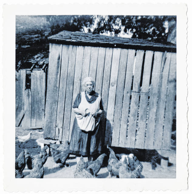This photo, one of dozens of undated, unidentified pictures kept by the Highland County Historical Society, depicts an elderly woman with some chickens near a barn-like structure. Do you know who she is? Where the photo might have been taken? When it might have been taken? We're interested. Call us at 937-393-3456, email us at HTGinfo@timesgazette.com or visit us on Facebook at www.facebook.com/TheTimesGazette.