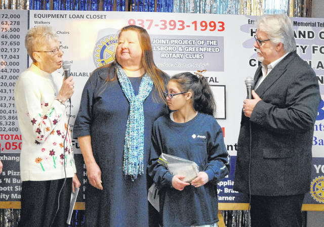 The poster child for the 2019 Ernie Blankenship Radio-Telethon for the benefit of the Highland County Society for Children and Adults, Emily Davis, second from right, is shown at the annual event with her aunt, Pam Chaney, second from left. Also shown are Gayle Coss, far left, and Herb Day, far right.