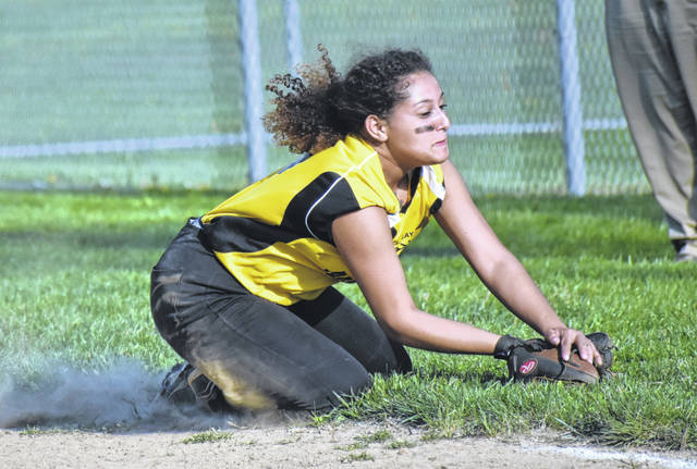 In this Times-Gazette file photo from Thursday, April 18, Lynchburg-Clay's Aaliyah Knight catches a pop up in foul territory at Lynchburg-Clay High School where the Lady Mustangs hosted the Whiteoak Lady Wildcats.