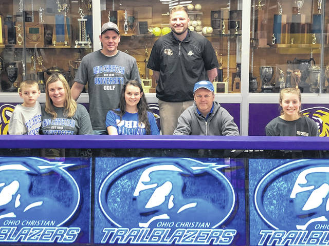 McClain Senior Cassidy Willis signed with Ohio Christian University on Friday at McClain High School and will continue her golf career with the Trailblazers in Circleville. Pictured front row (l-r): Remy Willis (brother), Gentry Willis (mother), Cassidy Willis, Ohio Christian Head Coach Lane Patrick and Catlin Willis (sister). Back row (l-r): Kyler Willis (father) and McClain Head Coach Jarrod Haines.