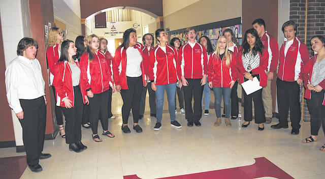 Students sing in support of Choral Director David White prior to Monday night's Hillsboro Board of Education meeting.