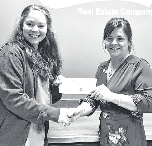 Karina Campton, left, is congratulated by Classic Broker/Owner Jenny Hilterbran on her first closing.
