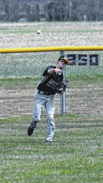 Lynchburg-Clay Senior Damin Pierson throws the ball from centerfield at Lynchburg-Clay High School on Saturday where the Mustangs took on the Rockets of Clermont Northeastern in a non-conference matchup.