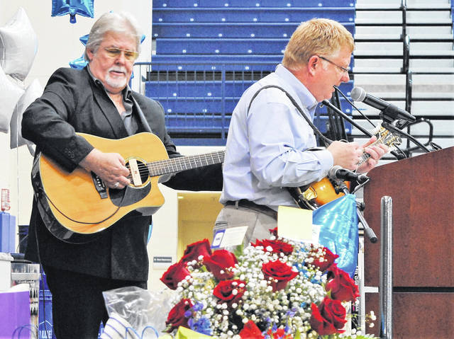 Local entertainer and longtime radio personality Herb Day accompanied Southern State College president Dr. Kevin Boys in a surprise duet.