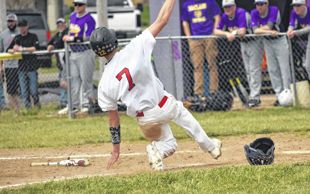 In this Times-Gazette file photo from Saturday, April 6, Fairfield's Ethan Grooms slides across home plate at Mitchell's Park in Greenfield where the Lions took on the McClain Tigers in a non-conference loss.