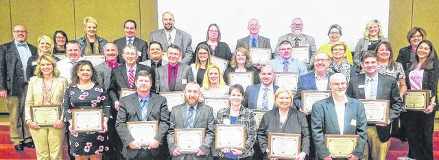 Educators honored at the Southern Ohio Educational Service Center 22nd annual Four County School Board dinner and meeting are pictured.