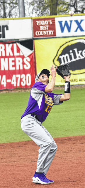 McClain's Garrison Banks tracks a pop up in the outfield Saturday at Paints Stadium in Chillicothe where the Tigers took on Clinton-Massie. The Tigers were back in action Monday when they traveled to Jackson to take on the Ironmen in FAC baseball action.