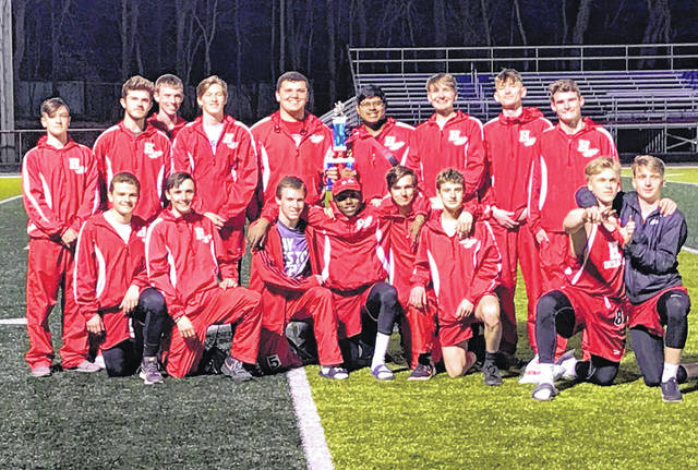 The Hillsboro High School boys track and field team is pictured at Zane Trace High School with their first place trophy from the Zane Trace Invitational on Thursday, March 28. The Lady Indians finished third in the girls competition.