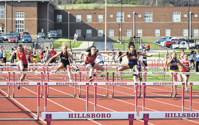 Girls from Fairfield, McClain, Hillsboro, Miami Trace, Eastern Brown and Washington compete in the girls 100-meter hurdles on Thursday at Hillsboro's Track and Field complex during the Hillsboro Invitational. For full results from this event and many other local high school sporting events please visit www.timesgazette.com. Full results from the Hillsboro Invitational will also appear in Saturday's edition of The Times-Gazette.