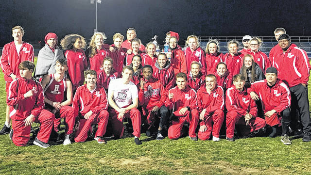 The Hillsboro Indians and Lady Indians Track and Field teams pose for a picture with their first place trophies from the RL Davisson Invitational at Southeastern High School on Thursday.
