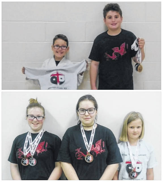 In both photos members of the Cross County Bushido Karate Club display medals won at the Annual Way Warriors Karate Classic.