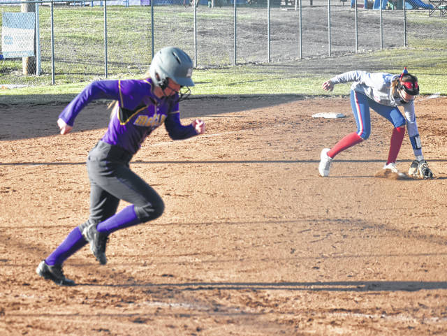 McClain's Kyla Burchett hustles down the first base line on Monday at Mitchell's Park in Greenfield where the Lady Tigers took on the Peebles Lady Indians in a non-conference softball matchup.