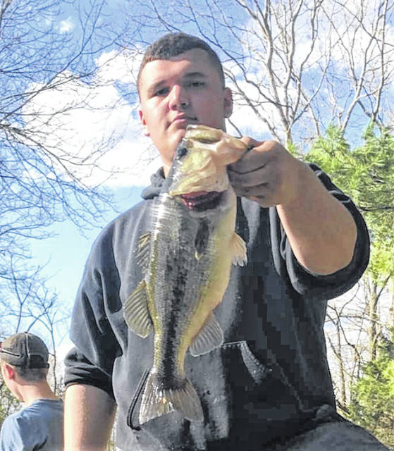 Draven Stodgel is shown proudly displaying a largemouth bass he caught at a private pond Sunday near Sugar Tree Ridge. Ohio's Free Fishing Weekend is May 4-5.