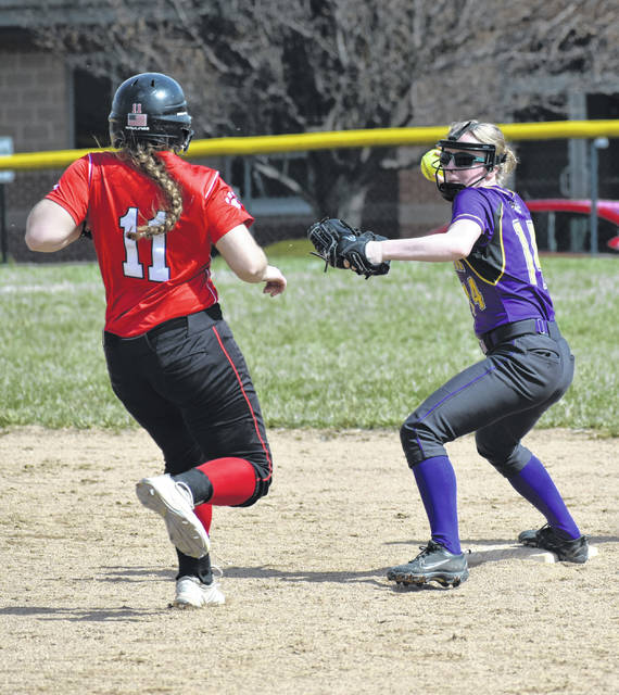 McClain's Kyla Burchett tags second base and turns to throw to first as Fairfield's Lauren Arnold approaches the bag on Saturday at Fairfield High School where the Lady Lions hosted McClain and Piketon in non-conference tri-match of softball games.