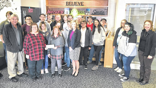 Merchants National Bank recently donated $500 to the Hillsboro After Prom Party. Bank representatives are pictured here with Hillsboro High School students and After Prom Committee members. Pictured in front to the left, from the left, are MNB's Paul Pence and Bertha Hamilton, Elaine Gilliland with the After Prom Committee and MNB's Denise Fauber.