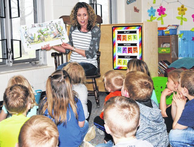 Kindergarten teacher Stephanie Carson reads to her class during a typical day at Bright Elementary School. Carson is one of four kindergarten teachers at Bright Elementary that try to impart to her students the love of and importance of reading.