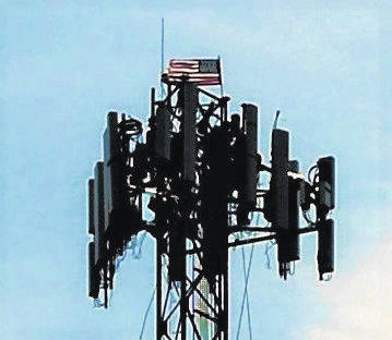 The stars and stripes waved proudly 285 feet atop a cell phone tower Tuesday at the corner of Point Liberty Road and S.R. 136 south of New Market. A crew of four was making a 5G upgrade for AT&T at the time.