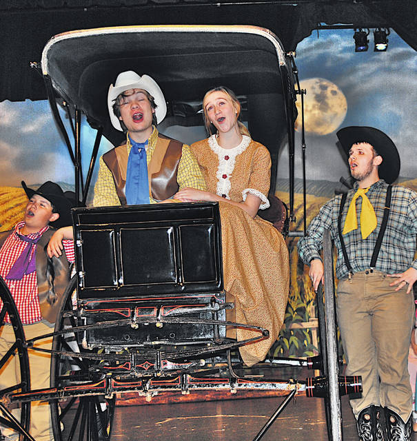 "Christopher Jacky (seated, left) and Clara White (seated, right) are pictured during rehearsal Tuesday for Hillsboro High School's production Friday, Saturday and Sunday of the Rodgers and Hammerstein musical classic ""Oklahoma."""