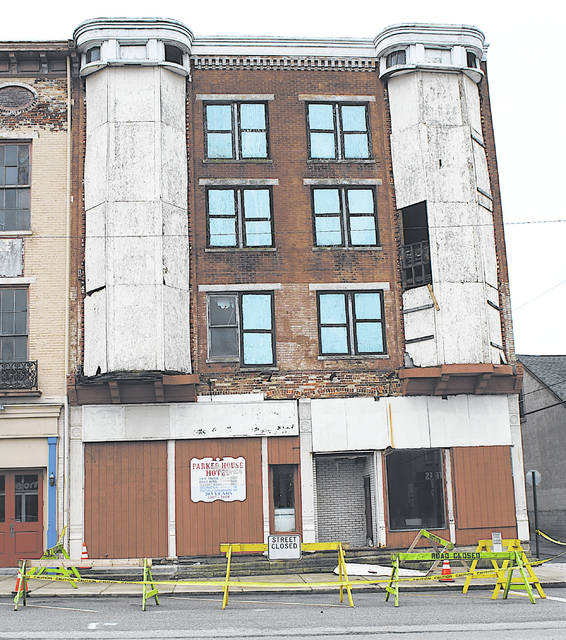 "The City of Hillsboro has barricaded the Parker House and sidewalk and parking spaces in front of the old structure in the 100 block of West Main Street, along with the alley on its west side. ""A recent windstorm loosened a number of different items on the structure — metal flashing, framing, and window cover-ups,"" Hillsboro Safety and Service Director Mel McKenzie said Friday. ""Quite a few pieces have fallen off since onto the alley, sidewalk and parking stalls. The owner has been notified and been informed to remedy the deficiencies, but until then I have a responsibility for the general public, hence the fencing and alley closure."""