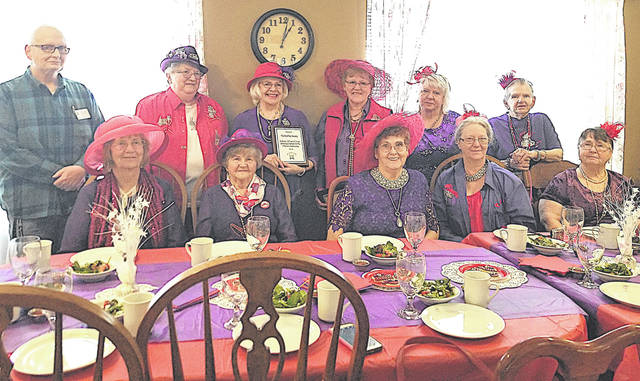 A luncheon in honor of the Red Hat Society was held recently at Bell Gardens Place in Hillsboro. The Red Hat Society has been involved in helping Highland County with needs and support with fundraising and donations. A plaque was presented by Michael Bradford, Bell Gardens executive director, in honor of the 21 years of service from the Red Hat Society.
