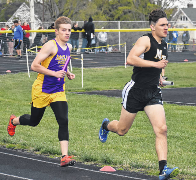 McClain's Reece Schluep keeps pace with Miami Trace's Jotham Lewis in the boys 4x800-meter relay on Friday at McClain High School where the Tigers and Lady Tigers hosed the Bob Bergstrom Invitaional.