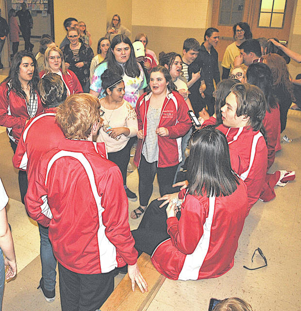 During an executive session at Monday's board of education meeting, Hillsboro students pass the time singing songs in support of Choral Director David White.