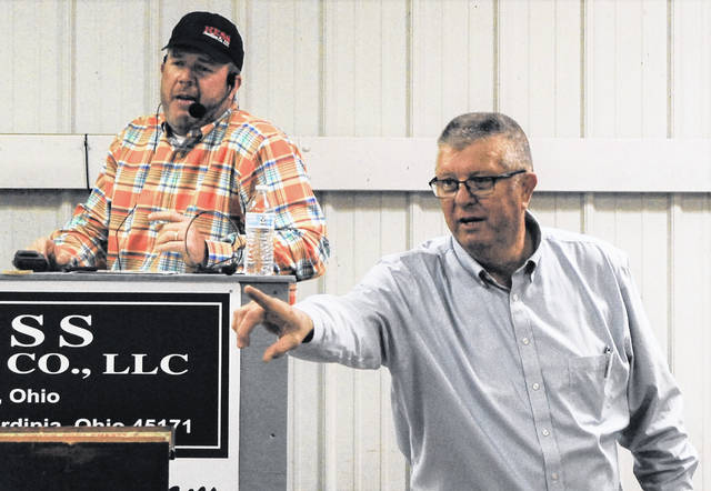 The father and son team of Brad, left, and Glenn Hess are hard at work during a recent auction at the Highland County Fairgrounds. Brad Hess has been calling auctions since 1991 while Glenn is now in his 52nd year of auctioneering.