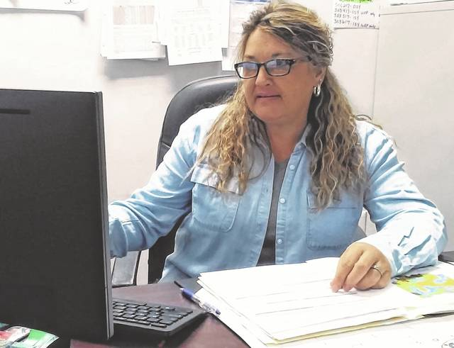 Rhonda Fannin, director of workforce services with Ohio Means Jobs Highland County, studies the statistics and trends of the latest economic report from the U.S. Department of Labor.
