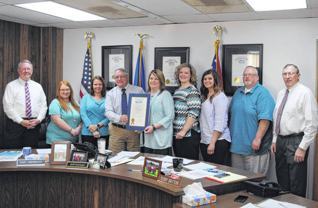 The Highland County Board of Commissioners is shown Wednesday with representatives from the Hillsboro Alternatives to Violence Center after approving a proclamation declaring April 2019 Sexual Assault Awareness Month in Highland County.