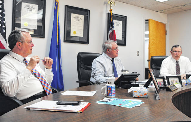 Shown from left are Highland County commissioners Gary Abernathy, Jeff Duncan and Terry Britton at the commissioners office Wednesday morning.